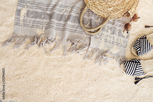 Fotografia  Beach towel on sandy floor