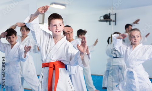 Door stickers Martial arts Children training new moves during karate class