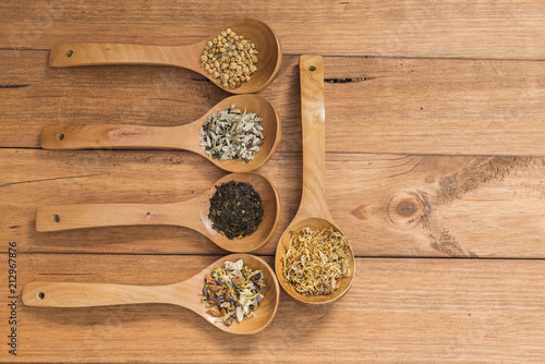Fotografie, Obraz  Wooden spoons with different herbs for infusion.