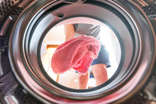 Young Man Doing Laundry View F...