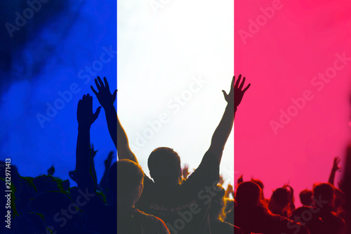 Papiers peints Singapoure football fans supporting France - crowd in stadium with raised hands against french flag - fifa world cup