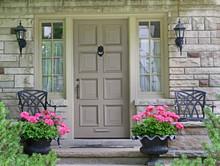 Front Door Of House With Flower Pot.