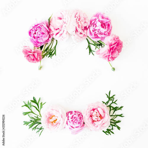 Tuinposter Bloemen Floral frame made of rink roses and green leaves on white background. Flat lay, top view. Flower background