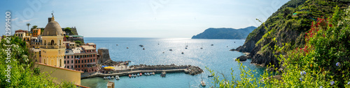 Garden Poster Liguria Panoramic View of the Bay in front of the Town of Vernazza on Blue Sky Background.