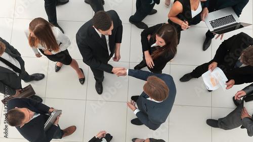 Deurstickers Wanddecoratie met eigen foto Handshake between competitors before the start of business negot