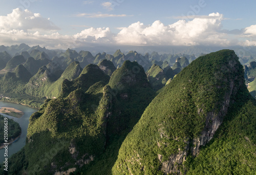 Foto op Canvas Bleke violet aerial view of farmland and mountain around the ancient town of Xingping, China