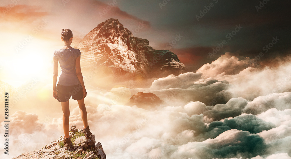 Fototapety, obrazy: Hiker on peak with tall mountain in background