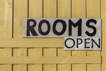 Sign 'Rooms Open' On Yellow Wo...