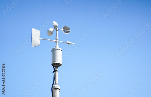 Wind vanes with blue sky background Wallpaper Mural