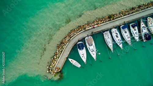 Fotografie, Obraz Sailboats and small yachts anchored at Lake Balaton, Hungary