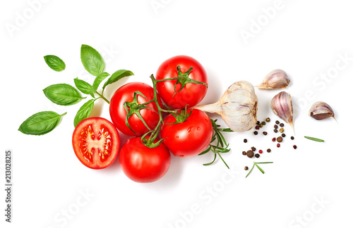Ripe red tomatoes with basil, rosemary, garlic and pepper isolated on white background. Top view.
