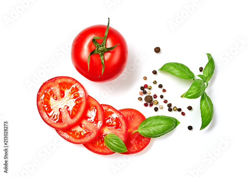 Ripe red tomatoes with basil, rosemary and pepper isolated on white background. Top view.