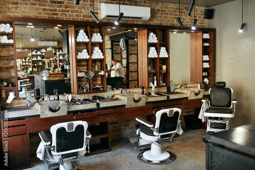 Barber Shop Interior. Men Beauty Hair Salon With Antique Chair