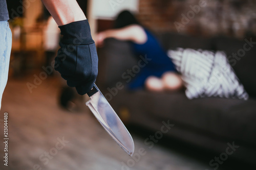 Wicked and evil murderer attempt to kill a woman in danger with a knife - homicide and violence society problem concept Wallpaper Mural
