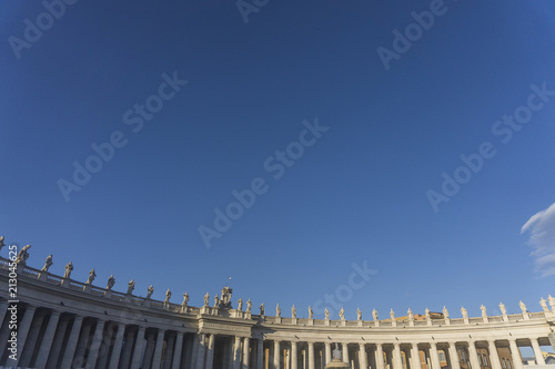 Canvas Statues ontop of the colonnades in St Peter's square, Vatican City, Rome, Italy