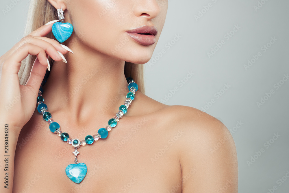 Fototapeta Beautiful female model with turquoise jewelry necklace and earrings