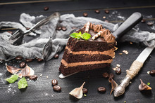 Delicious Piece Of Chocolate Cake With Layers On The Black Background