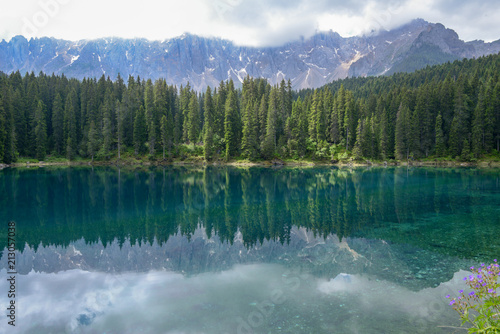 Poster Bergen Lake Carezza with reflection of mountains in the Dolomites