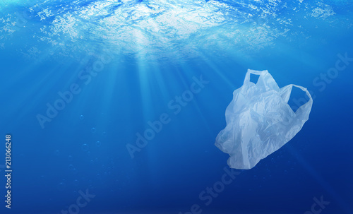 fototapeta na lodówkę environmental protection concept. plastic bag pollution in ocean