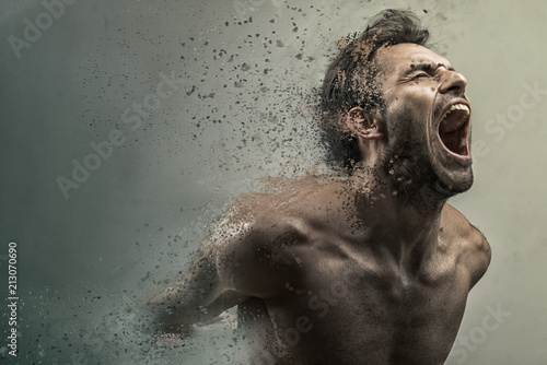 Screaming frustrated man dispersing and disintegrating into particles, agonizing Canvas Print