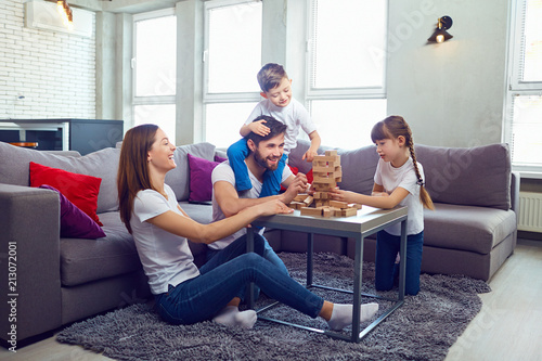 Happy family playing board ...