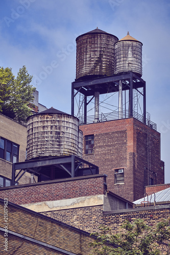Foto op Canvas Amerikaanse Plekken Water tanks on a roof, one of the New York City symbols, color toned picture, USA.