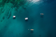Small Boats Navigating Beautiful Blue Ocean