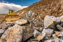 Bulldozer Among Huge Rocks And...