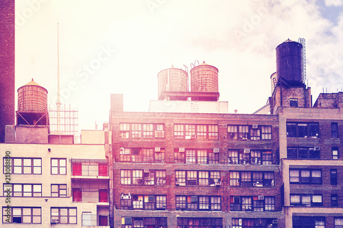 In de dag New York City Water tanks on a roof at sunset, color toned picture, New York City, USA.