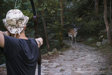 Hunter With An Arrow Aimed At ...