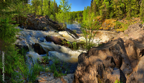 Foto op Aluminium Rivier River with steep rapids and rocky shores