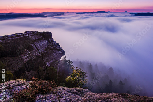 Foto op Plexiglas Aubergine Dramatic sunrise on the rocks. Amazing sky and clouds, fog in a valley, forest. Trees, rocks, sky, peace, quiet, relax, travel, adventure.