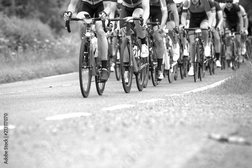 Photo sur Toile Velo Cyclists on bikes in a race