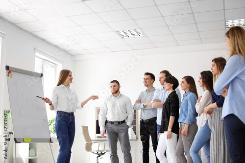 Female business trainer giving lecture in office Fototapeta