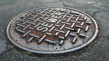 Sewer Metal Cap On The Road Af...