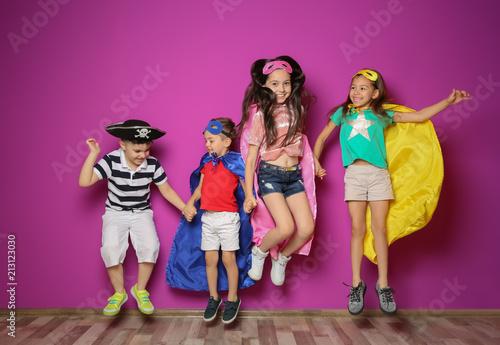 Fotografía Playful little children in cute costumes indoors