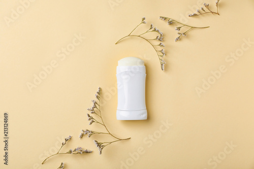 White deodorant and herbs on color background Wallpaper Mural