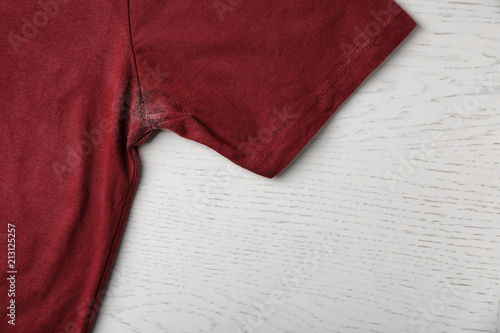 Photo T-shirt with deodorant stain on light background, closeup