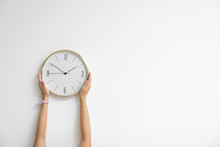 Woman Holding Clock On White Background. Time Concept