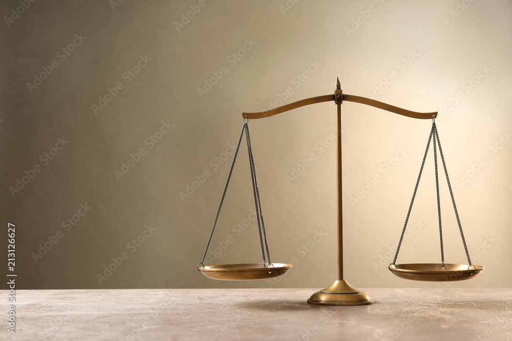 Fototapeta Scales of justice on table. Law concept