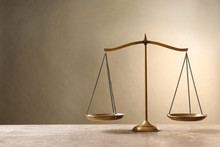 Scales Of Justice On Table. Law Concept