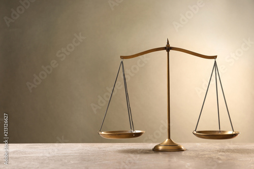 Slika na platnu Scales of justice on table. Law concept