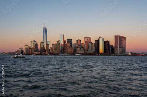 Photo Stands New York New York city skyline sunset view from the boat to Ellis Island