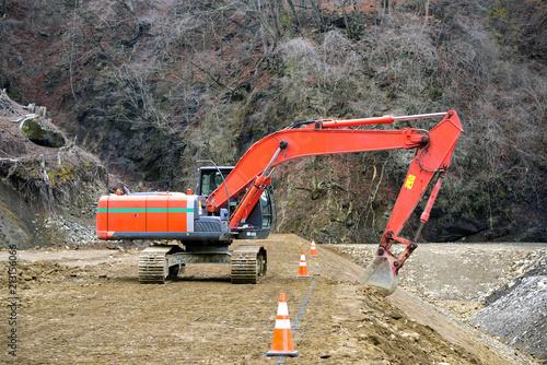 Tablou Canvas Construction site: Backhoe making banked slope