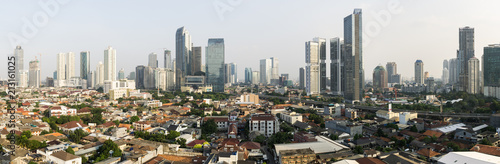 Poster de jardin Paris Stunning panorama of Jakarta South Central Business district contrasting with low rise residential middle class housing area in Indonesia capital city in Southeast Asia
