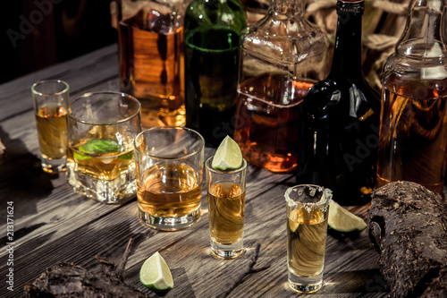 Alcohol in an old bar on a pirate ship with vintage rum and whiskey - 213171624