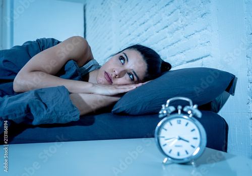 Obraz pretty latin woman can't sleep in insomnia concept - fototapety do salonu