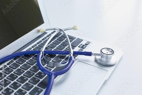 Cuadros en Lienzo Stethoscope lying on a laptop keyboard in a concept of online medicine or troubl