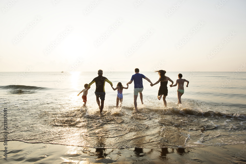 Fototapety, obrazy: Family playing at the beach
