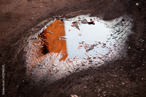 Cuadros en Lienzo A puddle of oil on the street. Pollution concept.